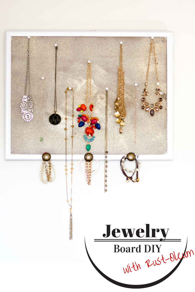 this easy DIY jewelry board is a chic way to keep your necklaces, earings, and bracelets organized