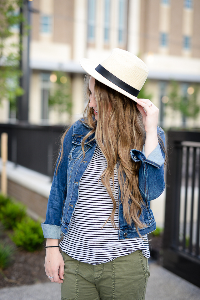 green pants, striped linen tee, and denim jacket with panama hat - summer staples
