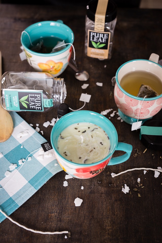 these easy DIY scented candles are infused with your favorite tea blend (and how cute is the little teacup?)
